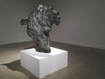 front of sculpture